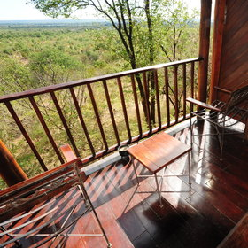 Each room has it's own balcony overlooking the Zambia National Park and waterhole.