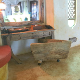… old traditional boats and Zanzibari artifacts are integrated into the fittings.