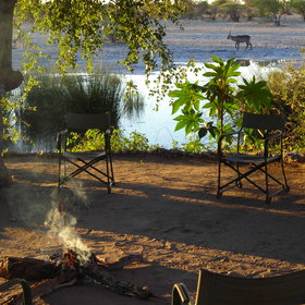 The camp fire provides the best place to watch a steady stream of animals come down to drink.