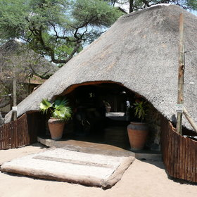 The main area at Elephant Valley Lodge is found in a lovely thatched building.