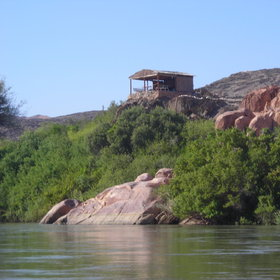 ...on top of large boulders overlooking the Kunene River.