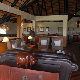 The main thatched building houses a lounge and dining area...