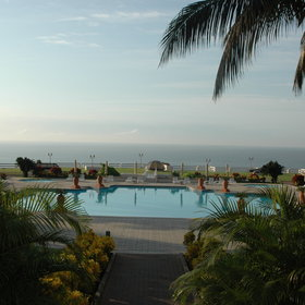 There is a large swimming pool available overlooking the ocean.