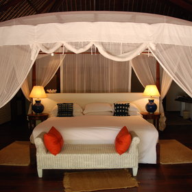 ...with king-sized beds, draped in mosquito nets.