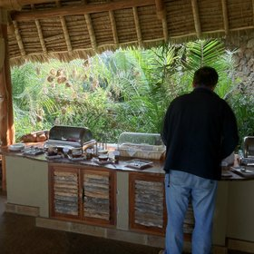 Meals - like this late breakfast - are served informally, with birds and other wildlife all around…