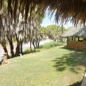 The lounge/dining area is right above the river, and hippos often come ashore at night to graze…
