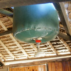 …and the traditional 'bucket showers', filled to order by staff, are in use.