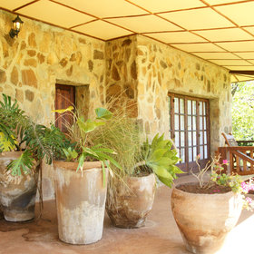 …each one with a cool, plant-filled verandah.