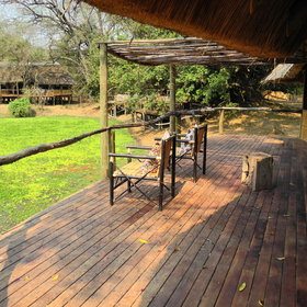 Outside each chalet is a private deck overlooking the waterhole...