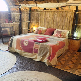 ... and there is a king-size bed in the honeymoon chalet - all with colourful fabrics.