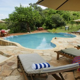 Entumoto is located on a wooded hillside and is unusual among tented camps in having a pool.