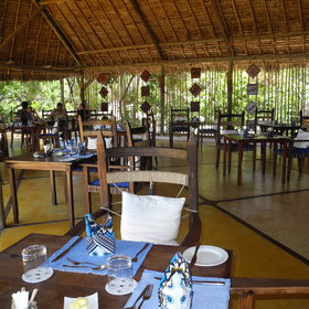 The dining area is situated under cool shady thatch.