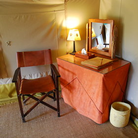 The tents also have a small writing table and chair.