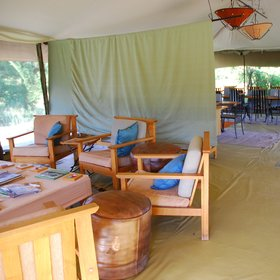 The central areas of Porini Lion Camp consist of a large lounge and dining tent…
