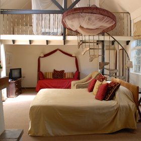 The striking Karen Blixen suite has a double height main room, with twin beds in the mezzanine…