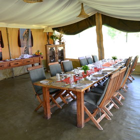 In the evenings, dinner is usually taken in the dining tent around one long table.
