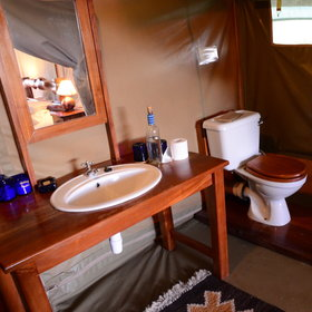 The en-suite bathroom is at the back of the tent.