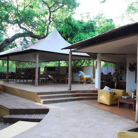 The main area is an open-plan lounge with a roof made of stretched canvas.