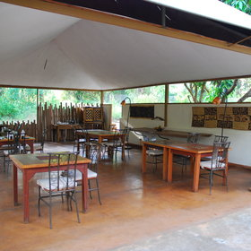 A few steps up, the airy dining area is also under canvas and has a distinctly African feel.