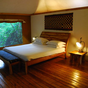 Each room is designed in a minimalistic style and has wooden furniture ...