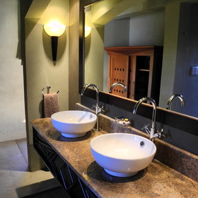 The open-plan bathroom has twin sinks…