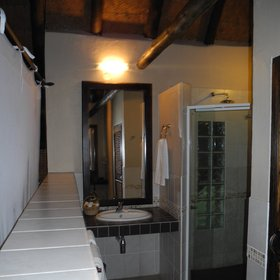 There's an en-suite bathroom at the rear of each chalet...
