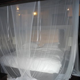 There's a queen sized bed with mosquito net...
