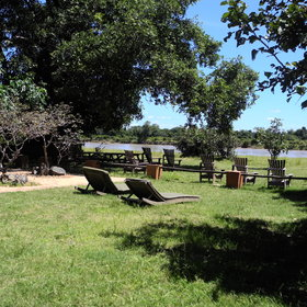 In the garden you have sunbeds and chairs with a fantastic view of the Luangwa River…