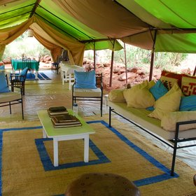 The main mess tent offers a lounge with comfortable sofas, and colourful cushions…