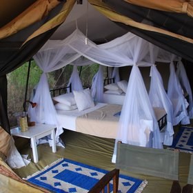 … or with two twin beds, and have mosquito nets and white side tables.