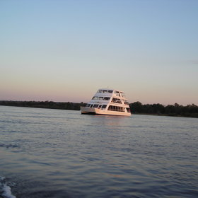 Enjoy a sunset cruise on the Lady Livingstone on the Zambezi River.