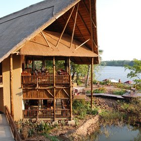 The David Livingstone Safari Lodge overlooks the 'Siloka' island in the Zambezi River.