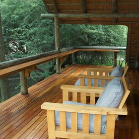 Each chalet has a shaded private deck and a couple of chairs at the front.