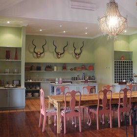 The dining area is open to the slightly modernised farmstyle-kitchen,…