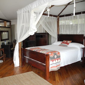 The interiors of the rooms each have two large double beds...