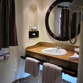 ...and a compact bathroom with a wash basin ...