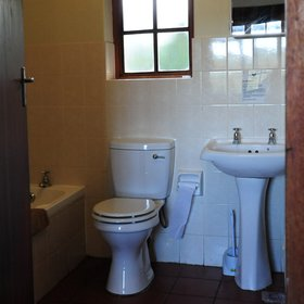 ...and an en-suite bathroom fitted with a bath, toilet, hand basin and shower.