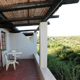…you can step out onto a private veranda overlooking the shrub-covered land.