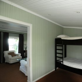 …an adjoining room with bunk beds for children...