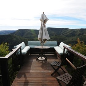 Relax in a sitting area with spectacular views over the mountains,...