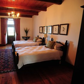 Alternatively, the bedrooms at the Opstal Manor have a more antique touch to them…