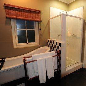 …and an en-suite bathroom with a shower, bath,…