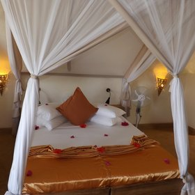 The large double beds have golden silk throws...