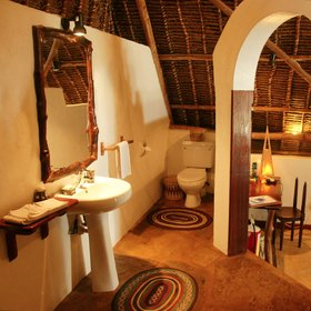 …wash basin and flush toilet. There is also a little writing desk in each room.