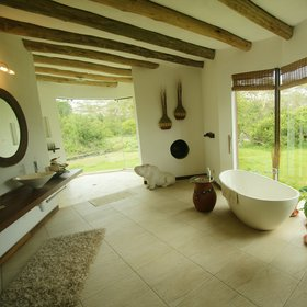 The huge, bright bathrooms are spectacularly conceived, with twin basins...