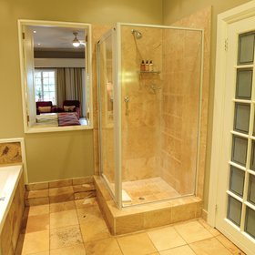 The en-suite bathroom is equipped with a shower,…