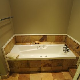 …a sandstone-tiled bath…