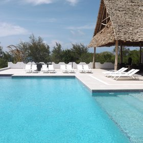 The pool has stylish sun loungers around its edge...
