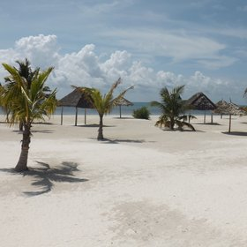 The beach has acres of white coral sand and plenty of shade.