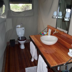 … an en-suite bathroom providing a flush toilet, a wash basin...